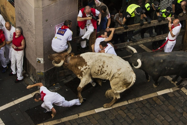 Joe Distler on his corner, July 7th, 2015 (Photo courtest of The Atlantic by Andres Kudacki - AP)http://www.theatlantic.com/photo/2015/07/running-of-the-bulls-2015-the-fiesta-de-san-fermin/398009/